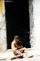 Rocinha: Boy in doorway